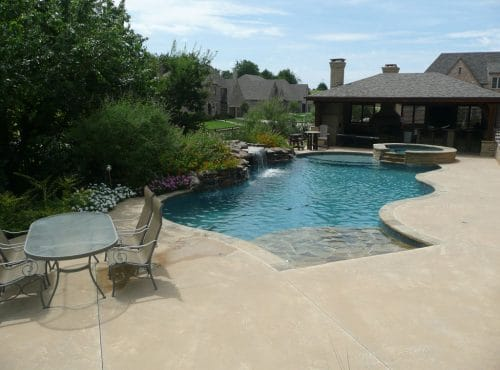 Custom Pool with Decking and Waterfeatures - McGee Pool