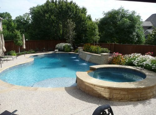 Custom Pool with Waterfeatures by McGee Pool